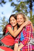 Girlfriends. Happy young women hiking portrait of smiling multiracial friends having fun together on