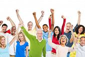 Multi-Ethnic Group Of People Raising Their Arms And Expressing Positivity