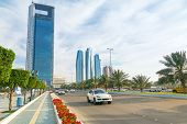 ABU DHABI, UAE - MARCH 29: Streets of Abu Dhabi with skyscrapers on March 29, 2014, UAE. Abu Dhabi is the capital and the second most populous city of the United Arab Emirates.
