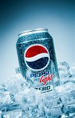 MOSCOW, RUSSIA-APRIL 4, 2014: Can of Pepsi cola Lignt on ice. Pepsi is a carbonated soft drink that is produced and manufactured by PepsiCo. Created and developed in 1893.