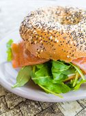 Fresh Salmon Bagel with fresh cheese and fresh lettuce on table