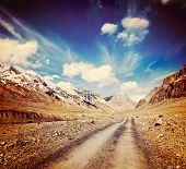 Vintage retro effect filtered hipster style travel image of Road in mountains (Himalayas). Spiti Val
