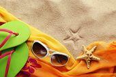 Beach accessories on sand beach