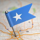 Somalia Small Flag on a Map Background.