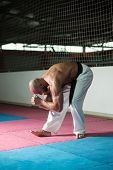 Mature Man Warming Up And Stretching