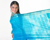 teenager girl in a tradition blue silk sari