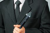 Businessman Holds Metal Crowbar