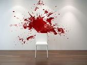 Artistic empty interior with a huge red splatter on the light grey wall behind a simple white chair placed on brown wooden parquet