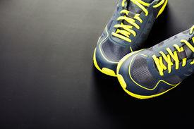 stock photo of triathlon  - Sport shoes on grey background - JPG