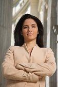 cross-armed businesswoman looking