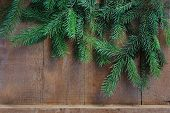 Close Up Of Selective Focus Brunch Of Christmas Tree On Wooden Background