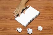 Hand Writing On Notebook With Crumpled Paper