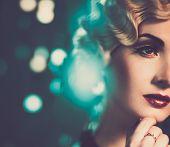 Elegant blond retro woman with beautiful hairdo