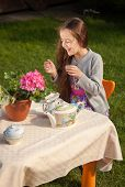 picture of laugh out loud  - Cute girl having breakfast at yard and laughing loud  - JPG