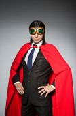 stock photo of superman  - Superman concept with man in red cover - JPG