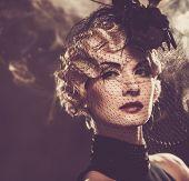 Elegant blond retro woman in veil with beautiful hairdo