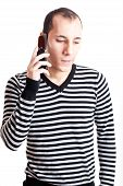 stock photo of young adult  - Young man talking on cellphone isolated on white background - JPG