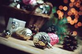 foto of wooden basket  - Vintage Christmas decorations in a wicker basket Christmas gift in retro style Christmas garlands cozy home decor soft focus - JPG