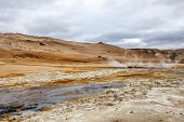 stock photo of gases  - Geothermal region of Hverir in Iceland near Myvatn Lake with fumaroles venting pressurised gases sulphur springs and hot boiling mud from volcanic activity - JPG