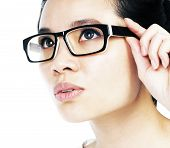image of asian woman  - Closeup of an attractive woman holding her eyeglasses over white background - JPG