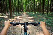 image of descending  - Mountain biking down hill descending fast on bicycle - JPG
