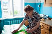 Elderly woman on the kitchen. Old woman at home