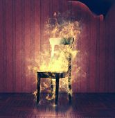 The burning chair in old vintage interior. 3d illustration. Creative concept