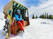 Skiing, winter sport, snow and sun - woman enjoying ski vacation