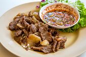 stock photo of wagyu  - Thai style grilled beef steak serve with fresh vegetable - JPG
