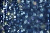 Christmas Night Abstract Background - Glittering Defocused Light and Stars