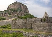 foto of domination  - Gingee fort dominates its hill fronted by ramparts and the top of the harem - JPG