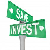 Save Vs Invest words on two way road or street signs with arrows pointing the way to different investment or savings choices to grow your portfolio or assets for retirement