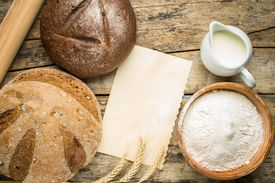 stock photo of recipe card  - Bakery ingredients with fresh loaf of bread and blank paper card for recipe or menu - JPG