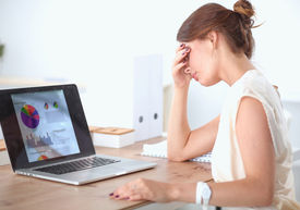 pic of disappointed  - Portrait of tired young business woman with laptop computer - JPG