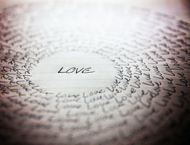picture of cursive  - the word love written on a lined piece of school paper in ink with a vignette and a circle of love  - JPG