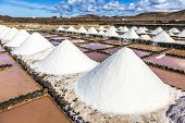 picture of salt mine  - salt piles in the saline of Janubio in Lanzarote - JPG