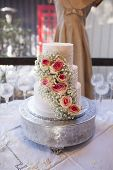 image of three tier  - Beautiful three tiered wedding cake with roses - JPG