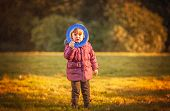 pic of frisbee  - Little girl throwing Frisbee in the park in autumn