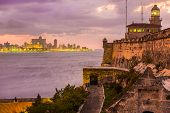 picture of el morro castle  - Beautiful sunset in Havana with El Morro lighthouse illuminated on the foreground - JPG