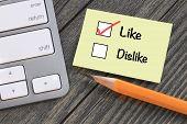 stock photo of dislike  - concept of like versus dislike - JPG