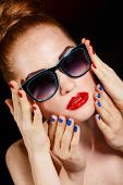 stock photo of freckle face  - Beautiful young model in sun glasses - JPG