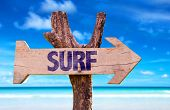 stock photo of watersports  - Surf wooden sign with beach background  - JPG