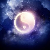 stock photo of karma  - Yin Yang sign in dark night sky - JPG