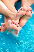 foto of hot-tub  - People feet relaxing in hot tub - JPG