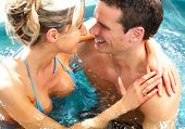 foto of tub  - Young couple relaxing in hot tub - JPG