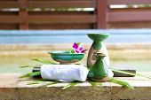 foto of massage oil  - Arrangement of spa treatment products made out of massage oil in ceramic bottle - JPG