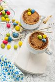 foto of easter candy  - Easter cream dessert tiramisu based in portioned cups are decorated sweet candy in the form of eggs - JPG