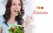picture of nutrients  - The word nutrients against brunette eating healthy salad - JPG