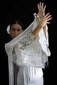 picture of cross-dress  - Flamenco dancer backs with white dress and hands crossed up on black background - JPG