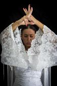 pic of cross-dress  - Flamenco dancer backs with white dress and hands crossed up on black background - JPG